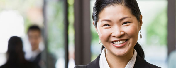 Asian woman with US work visa in business office