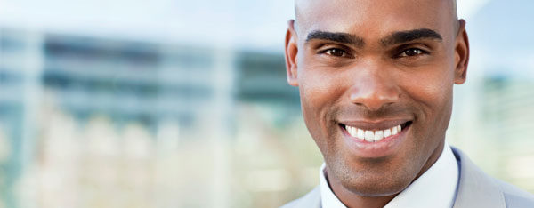 African man with US work visa in business office