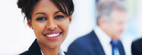 African woman with US work visa in business office