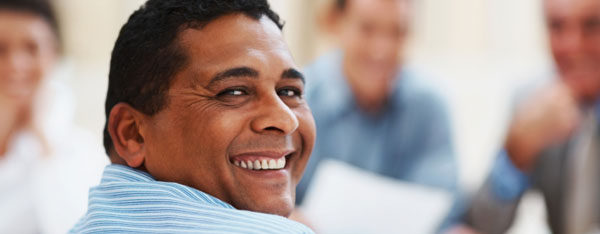 Latino man with US work visa in business office