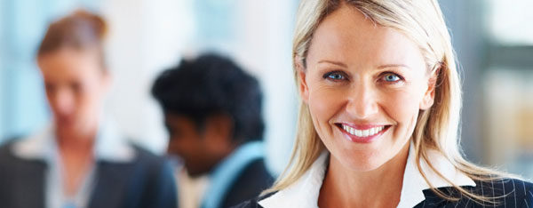 European woman with US work visa in business office